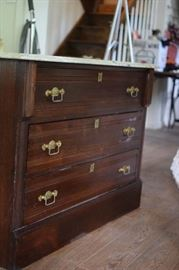 Marble top three drawer dresser.