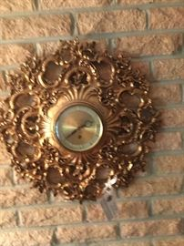 Gold-leaf wall clock.