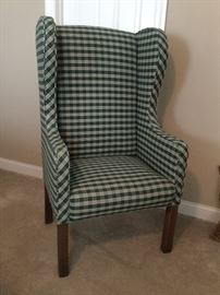 Upholstered wing-back chair