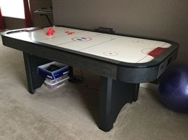 "Harvard air hockey table (80"" long). Excellent condition."