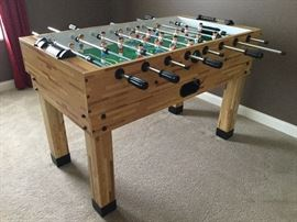 Harvard Foos Ball table. Converts to pool table and indoor shuffle board. Excellent condition.