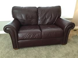 "Burgundy leather loveseat (60"")"