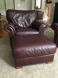 "Burgundy leather chair (42"" wide) and ottoman"