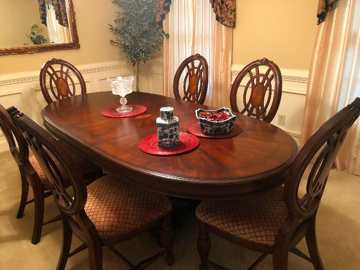 Oval Dining Room Set. Table is heavy wood with inlay design. 44x92x26, with leaf (44x29)