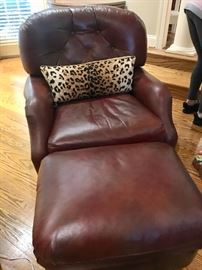 One of two leather chairs and ottomans (mint condition)