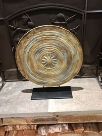 Large pottery plate on stand