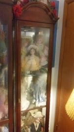 smaller curio cabinet with dolls