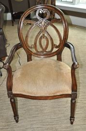 One of the four dining chairs with Carmel colored upholstered seat
