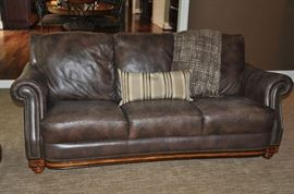 "82"" distressed brown leather sofa with brass nailhead design  36""h x 36""d"
