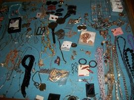 Three jewelry cases full of costume jewelry, some vintage
