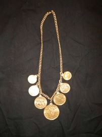 Gold coin necklace, $20 piece, two $10 pieces, two $5 pieces, two $2 1/2 pieces. 14 kt coin