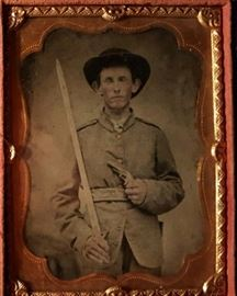 Armed Confederate soldier ambrotype photo