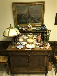 Oak buffet, slag glass lamp, Roseville & Hull pottery