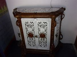 "Antique French Enamel cast iron stove cover repurposed as cabinet, shaped oval form with neoclassical decoration in brown and white enamel, four openwork doors and top with medallions of putti warming their hands at fires, acanthus leaves on the supports and scrolled feet, silverplate pulls, tin back pierced with a hole and two wood shelves, top also lifts up, expected wear and signs of use including some light surface scratching and loss to finish, some nicking and denting along corners and edges, consistent with age and use, measures 33 1/2"" h x 32"" x 13 1/2"" This is an estate item and is sold as is. Listed ebay at $1200.00 by other parties. Also listed $790.00 at https://myestatesale.wordpress.com/2012/04/28/antique-french-stove-heater/  Listed 1stdibs at  https://www.1stdibs.com/furniture/storage-case-pieces/cabinets/antique-french-enamel-cast-iron-room-heating-stove-repurposed-as-cabinet/id-f_8390233/ $1650 ----RARE ITEM OUR PRICE $500.00 obo.  3' wide x 14"" deep x 34"" tall"