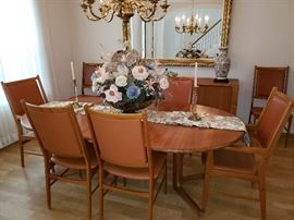 Round Scandavia Teak formal dining table- with 2 extension leaves (shown w/ both extension leaves inserted) 8 Teak & leather chairs (2  captain chairs)