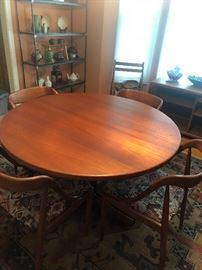Mid Century Modern Teak Dining Table has table pads and 2 extensions