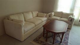 $60  crème sofa    $40  crème loveseat  $40   wood cocktail table     $25 rug