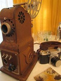 Vintage Praktica 35mm Camera, Vintage Stewart Warner Film Projector (in case), tripods, screens, etc.