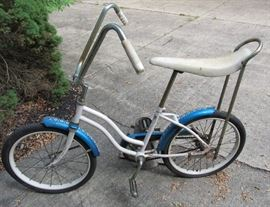 Vintage Huffy Girl's Banana Seat Bike, blue fenders with floral design, in great shape, barn find