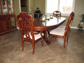 Elegant Dining Room Table and chairs with custom pads