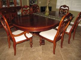 gorgeous dining table with 6 chairs and pads
