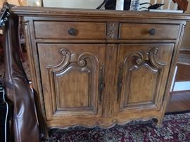 Great piece! Can be used anywhere! French Provincial! Has a black marble inset on top. Great as a server or bar!
