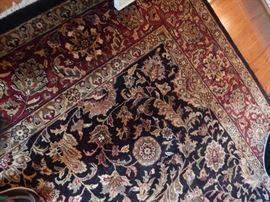 Wool room size carpet, extra plush and comes with pad.