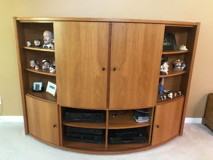 Such a cool unusual piece!  This is a curved front  Mid Century Teak entertainment center.  All four curved cabinet fronts close.  See other pictures for different looks.