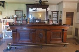 **** AVAILABLE FOR PRE-SALE ****                      Antique Saloon Bar from a saloon in McKinney, TX in 1968.  Front bar, brass foot rail and mirror are antique.  The back bar with a vintage wet sink was built by the homeowner.