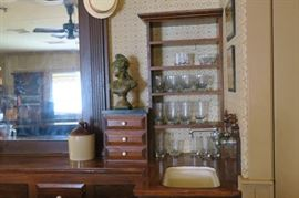 Back bar with lots of storage, vintage sink and drawers on top with marble were built years ago by the homeowner