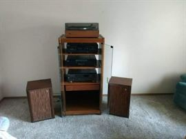 Stereo System with Speakers. Technics Stereo Receiver, Sony 5 CD Changer, Sony Dual Cassette Deck, Sansui Turntable and 2 Canal Speakers. Glass Cabinet
