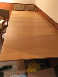 Blonde wood mid-century drop leaf table with leaves, six chairs