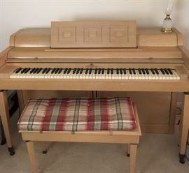 1955 Wurlitzer blonde wood spinet piano. Needs tuning but no apparent defects
