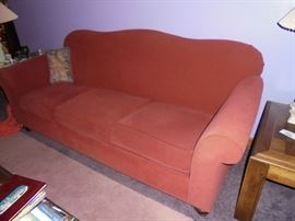 Coral color couch by Broyhill
