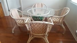$120   Glass table top with four coaster chairs