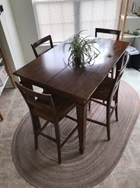 "Great multi-use high table that has hidden leaf. Opens up to create a square table that will seat 8. all 8 chairs are included.  36""w x 54""L x 41""h (open 54"" x 54"")"