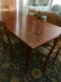 "Beautiful curly maple table (6'6"" by 42"" without extensions and 9'6"" with the two end of table extenders/leaves) and 8 chairs"