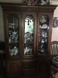 a nice china cabinet that has a matching table and chairs.  I lot of collectibles in this sale!