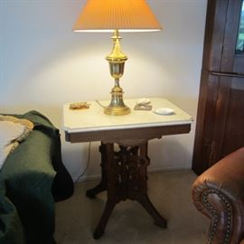 One of two Eastlake marble-top side tables