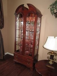 Baker Curio loaded with pink depression glass