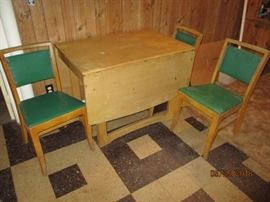 hard wood drop table with at least 3 chairs 2 leaves