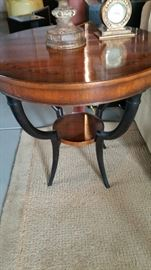 The perfect side table. Beautiful 30 inch round top with inlaid wood. Black legs 28 inches high. Sale price $400