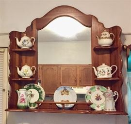 Dresser top that has been wall mounted for display. It displays decorative plates and tea pots.