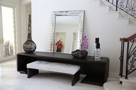 Mirror, candleholders and brown decorative bowl are sold.