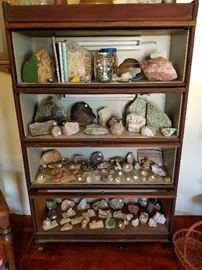 Lawyer's bookcase with lights for display. Hand cut, natural huge stone bookends, huge piece of rough rose quartz