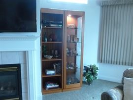 2 of 4 teak bookcases.  2 have glass doors.
