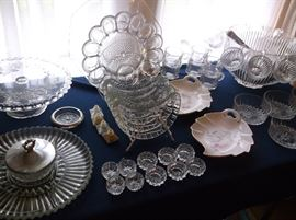 Pressed glass cake stand, egg tray, relish tray, salts w/spoons, and punch bowl set