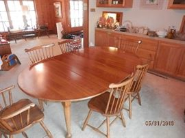"Leopold Stickley SOLID Cherry wood table with pads. Leopold Stickley SOLID Cherry wood chairs...2 arm chairs and 4 side chairs...Label ""1956"""