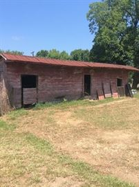 Old feed and hay barn, doors will be sold and the barn wood siding is for sale.