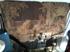 Antique tapestry, old fireplace tools, brass andirons